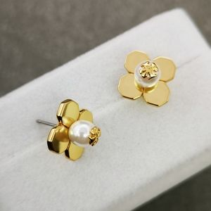 c8467c829 Tory Burch Jewelry - Tory Burch Babylon Gold Pearl Stud Floral Earrings